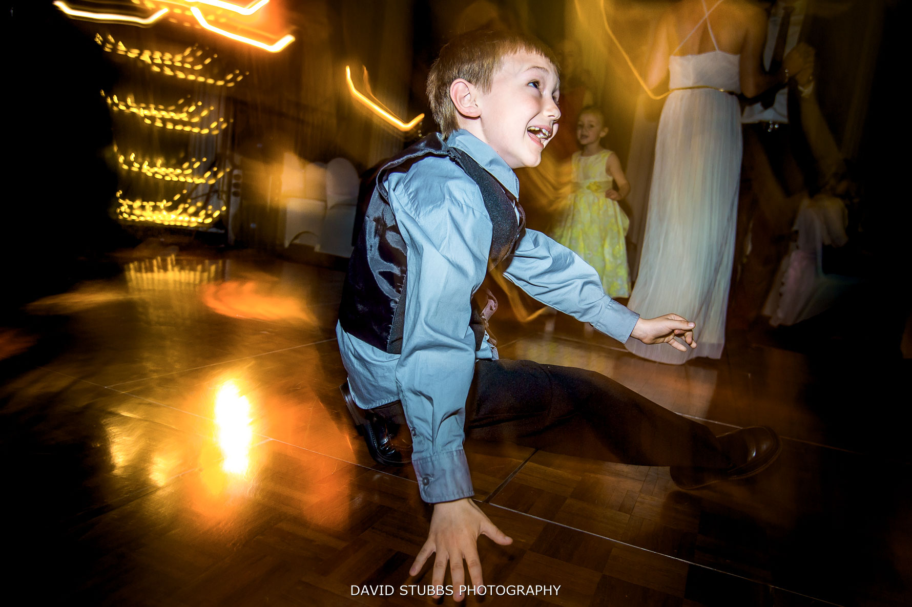 boy dancing at wedding