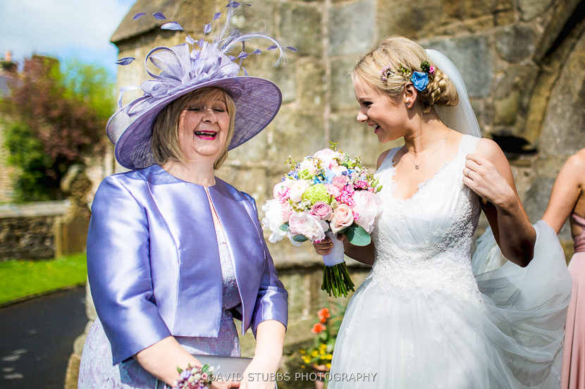bride laughing with woman