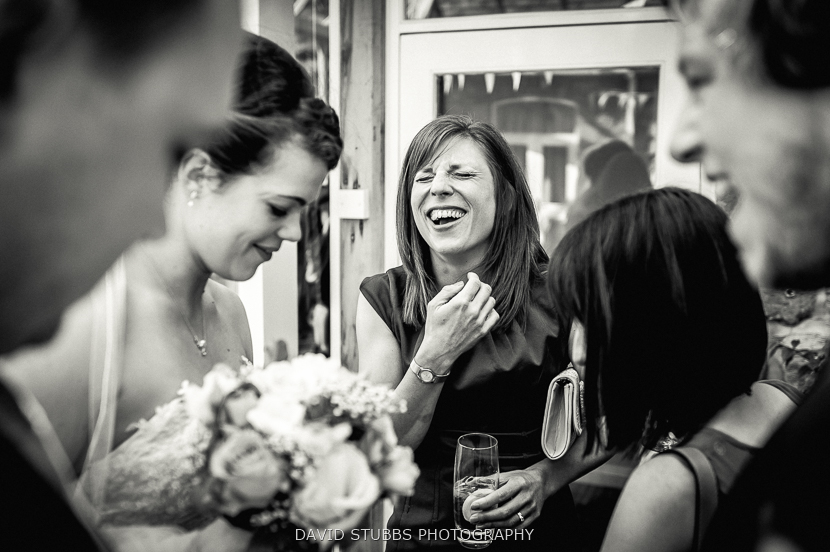 woman laughing with bride