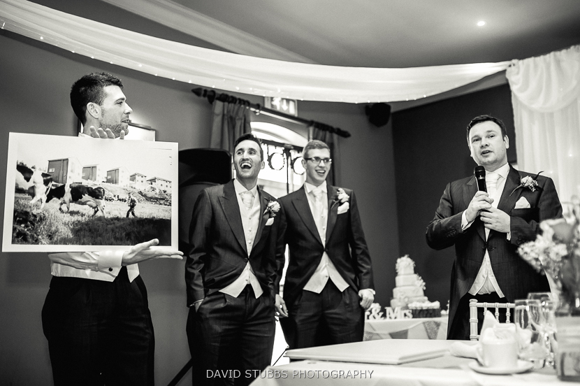 groomsmen holding picture