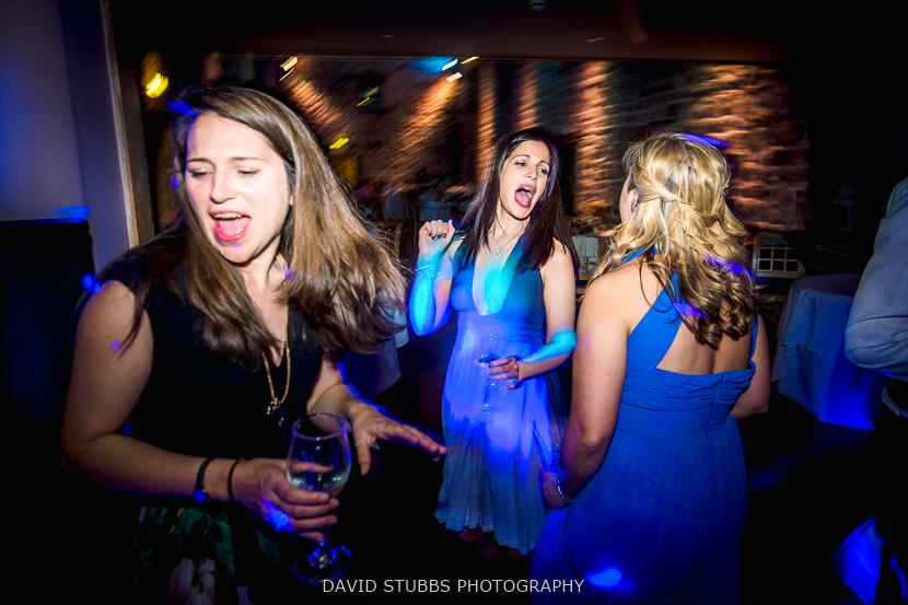 bridesmaids dancing at party