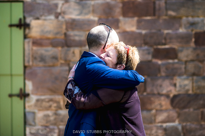 groom and woman hugging