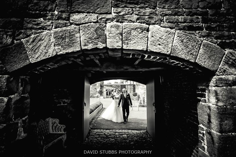 groom and wife going under bridge