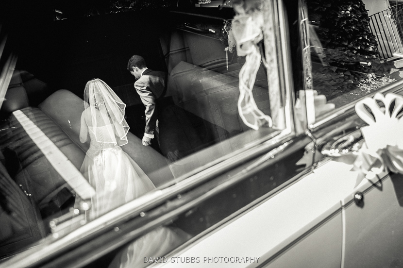 couple reflection in car