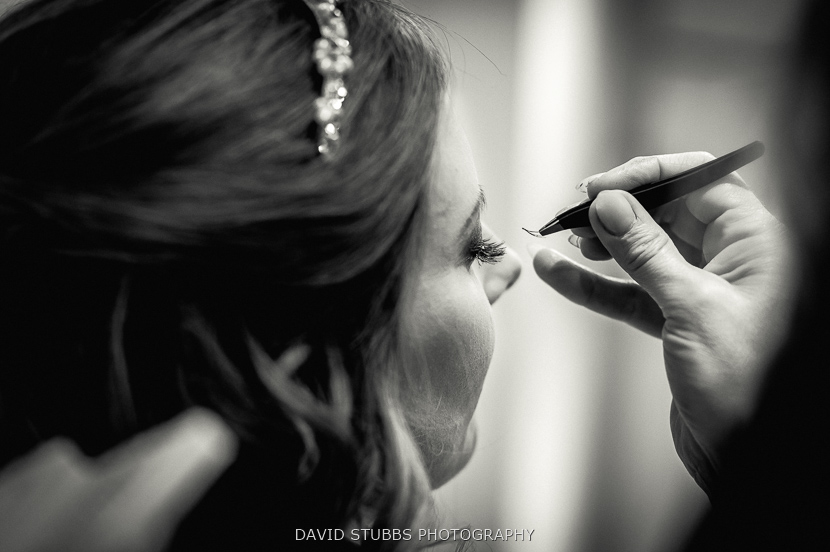 woman having eye-liner done