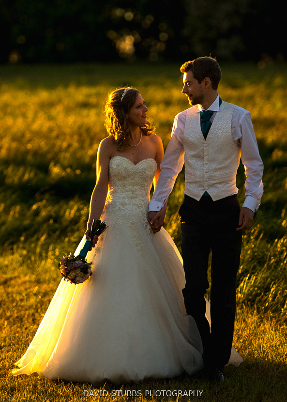 groom and wife on grass