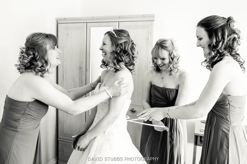 bridesmaids laughing black and white