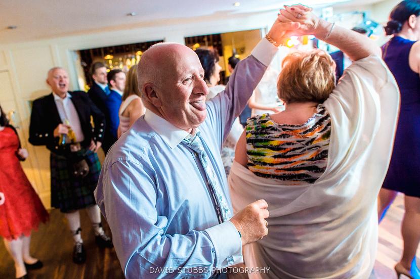 man spinning woman