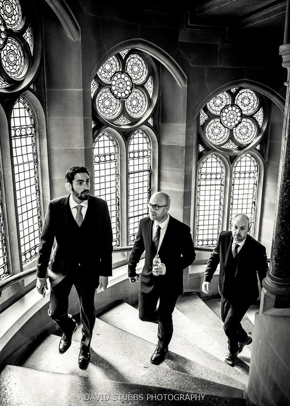 men on steps black and white
