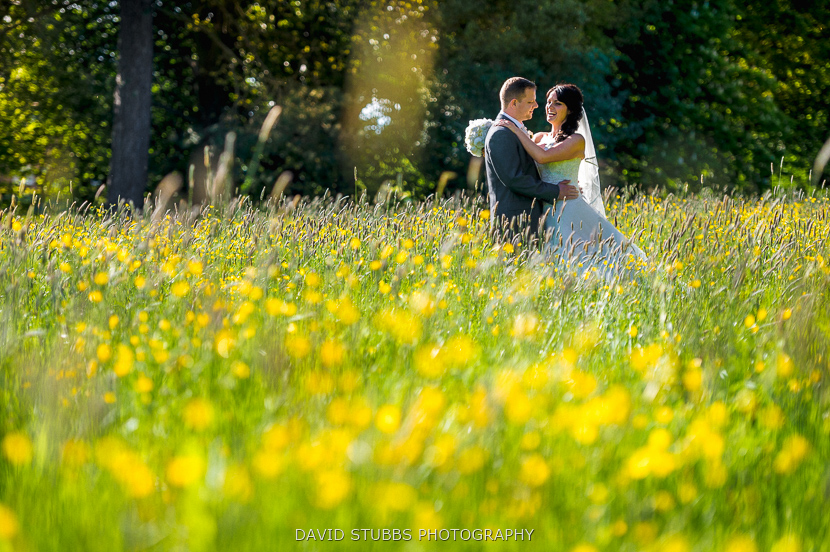 man and wife in yellow flowers