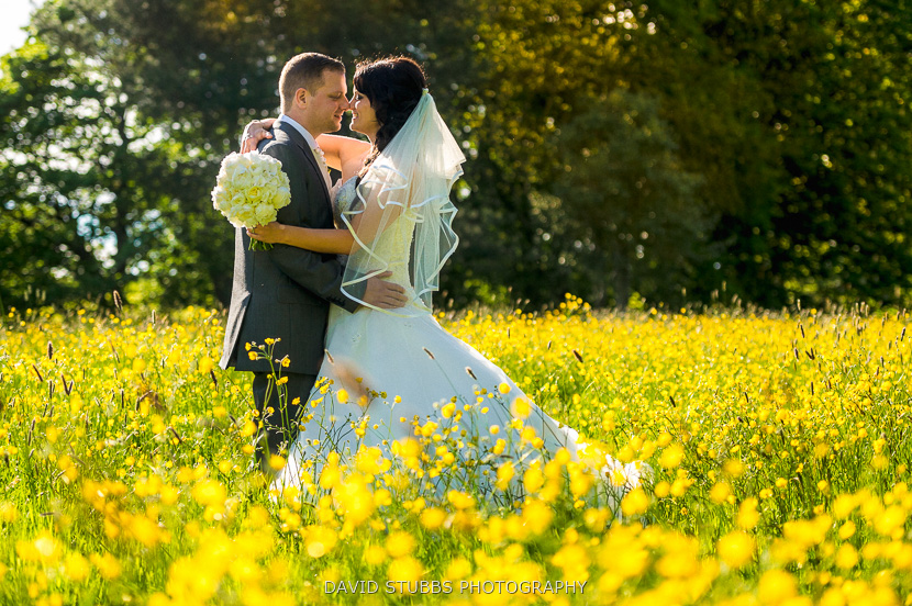 newly-weds in grass