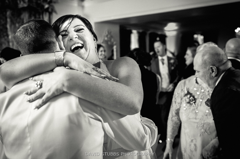 black and white hugging man and woman