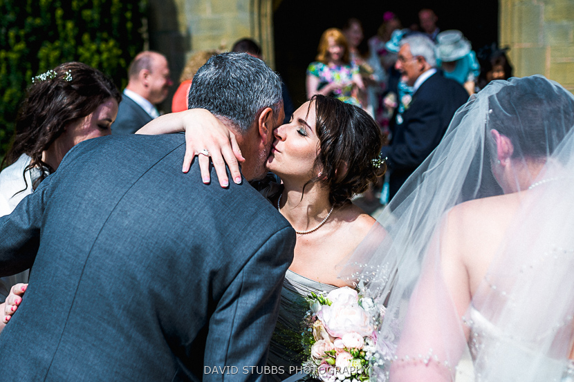 bridesmaids congratulating couple