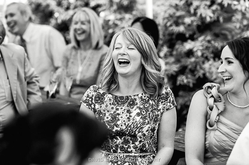woman laughing in marquee