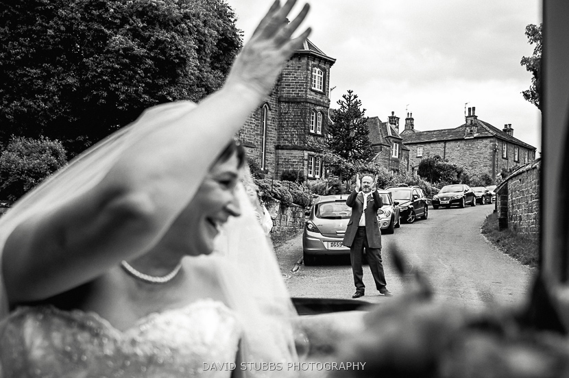 bride waving from car