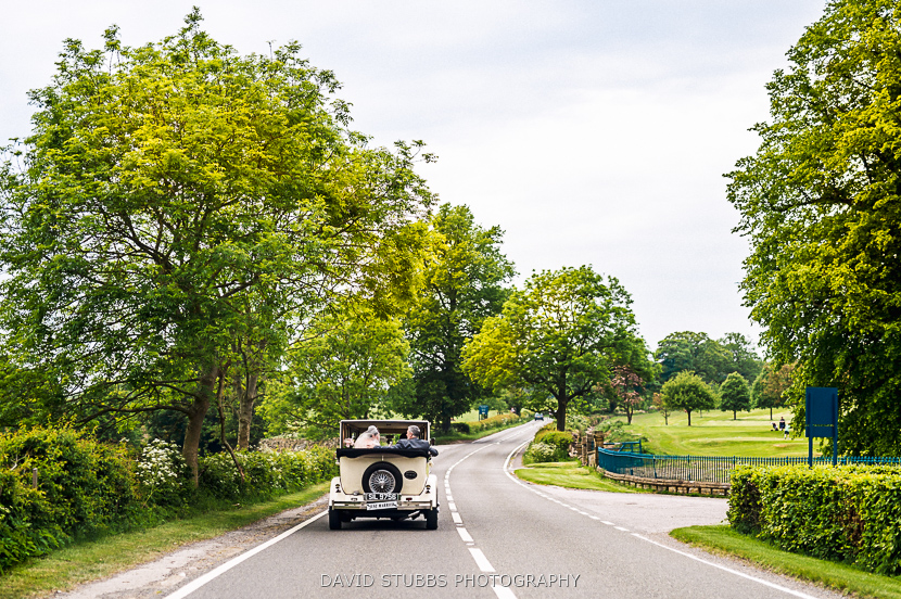 wedding car driving down road