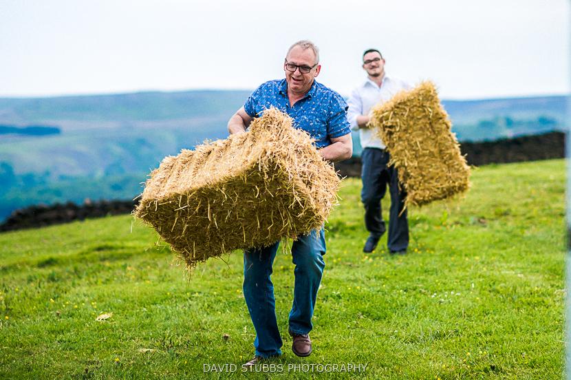 men carrying hay