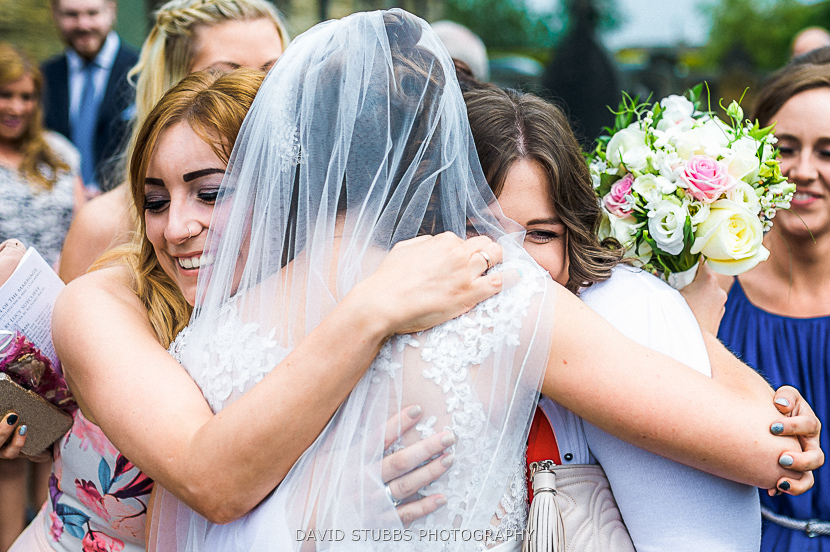 friends hugging bride