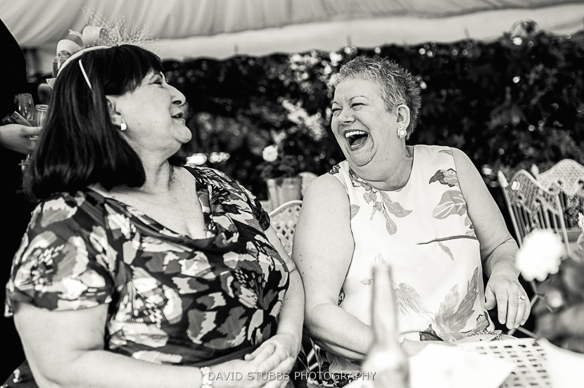 women laughing black and white
