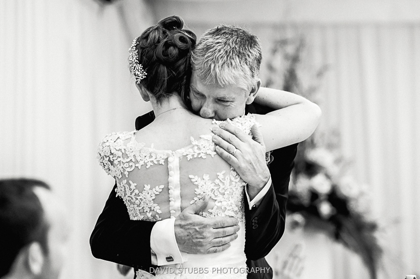 bride hugging dad