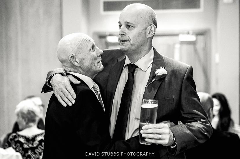 men hugging black and white