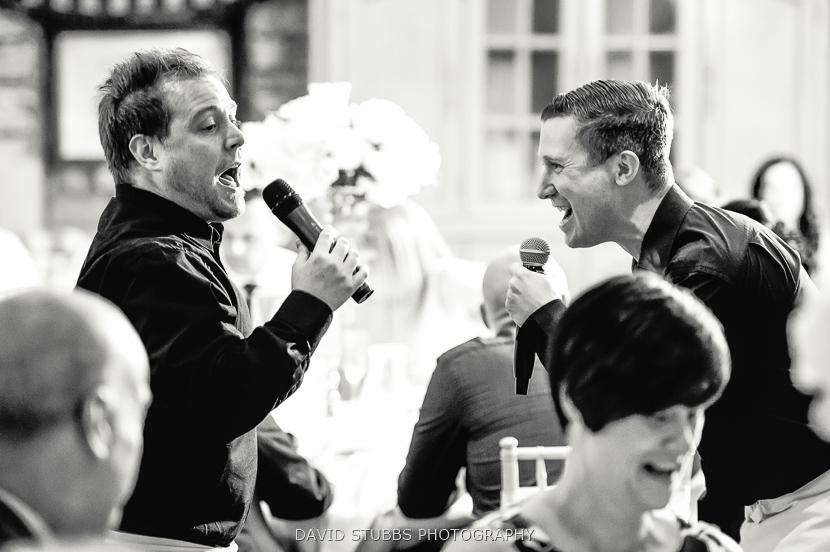 men singing black and white