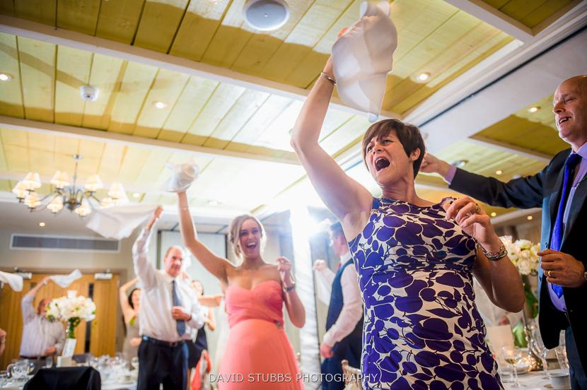 women waving napkins