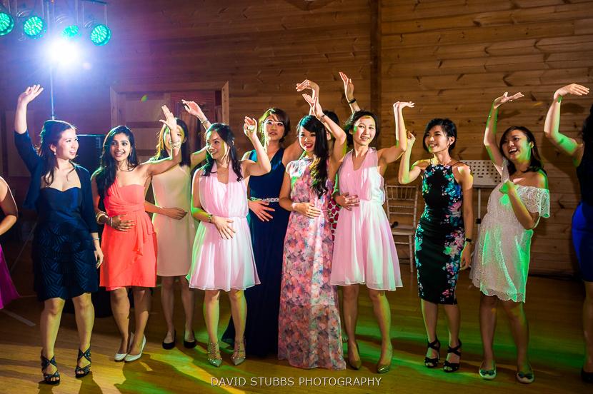 women waving arms