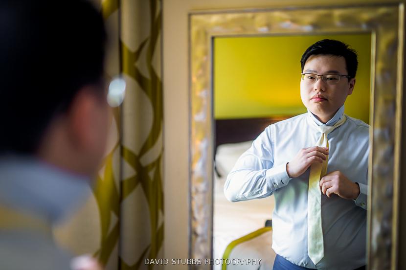 groom doing tie