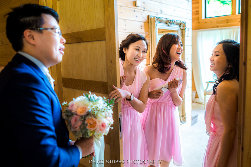 bridesmaids laughing with groom