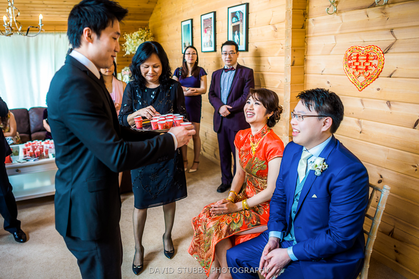 husband and bride being given cup