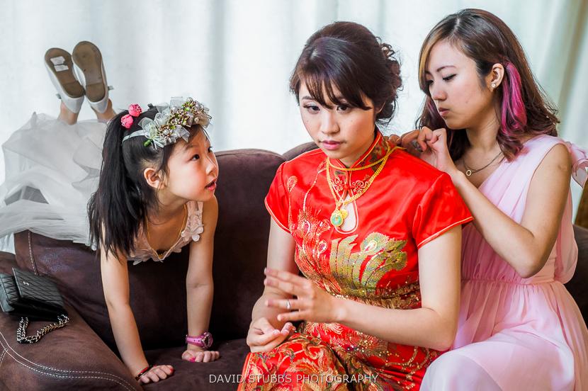 bride having necklace put on