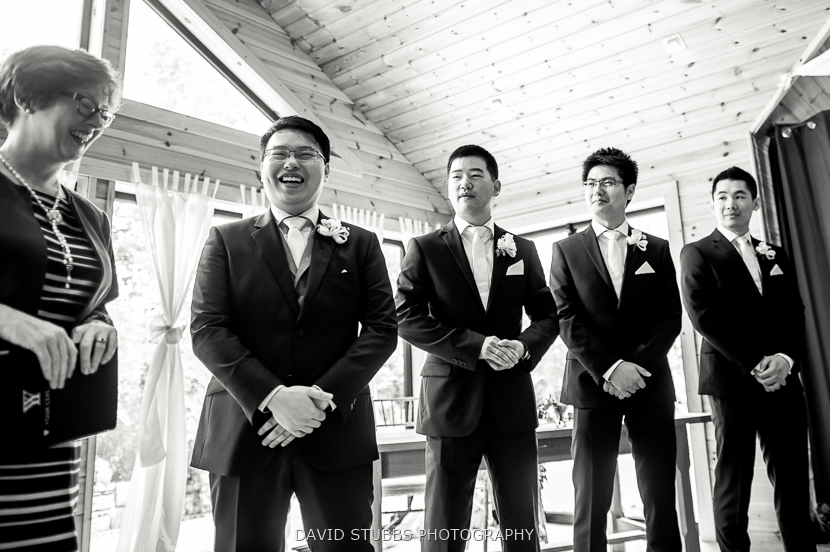 men waiting at ceremony