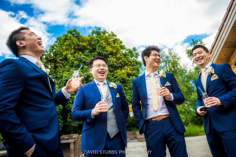 groom and men chatting