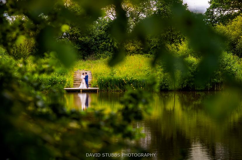 lake at styal lodge wedding photo
