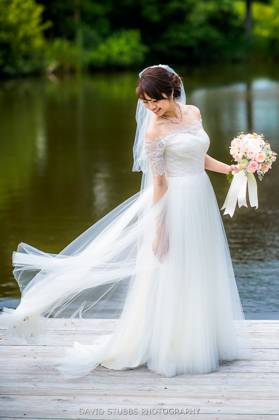 bride with veil blowing in wind