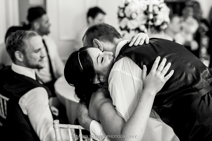 father hugging daughter black and white