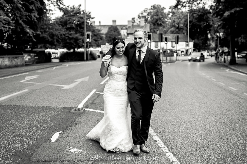 married couple walking in road