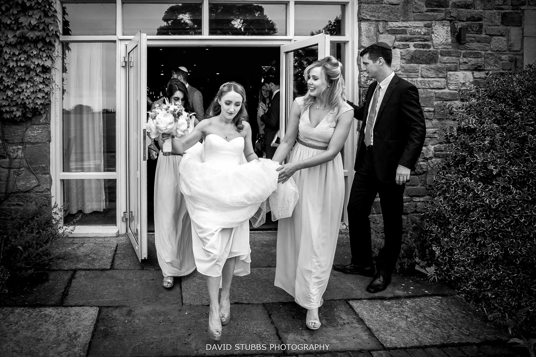 bride walking out showing dress