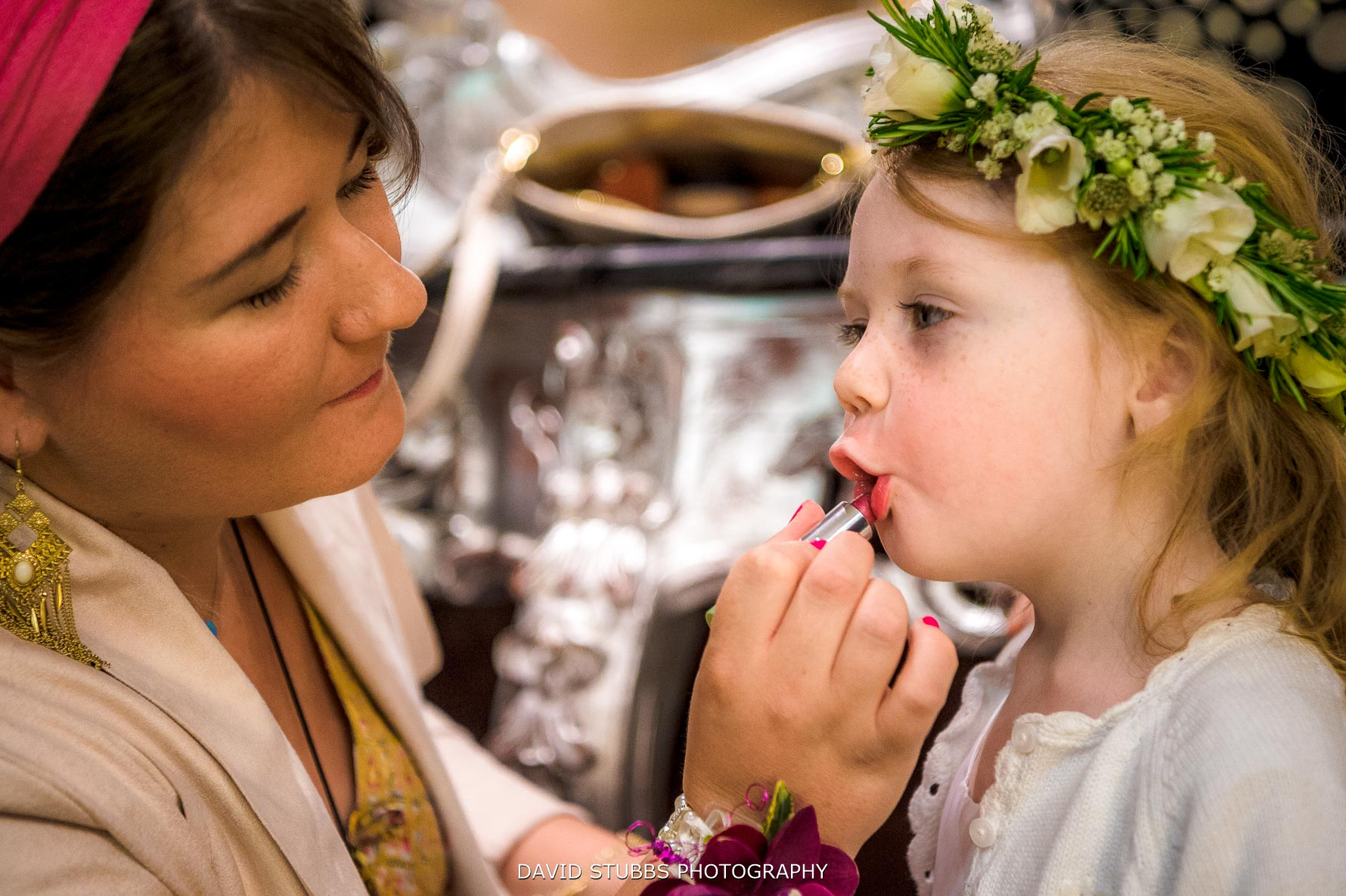 flower girl having lipstick put on