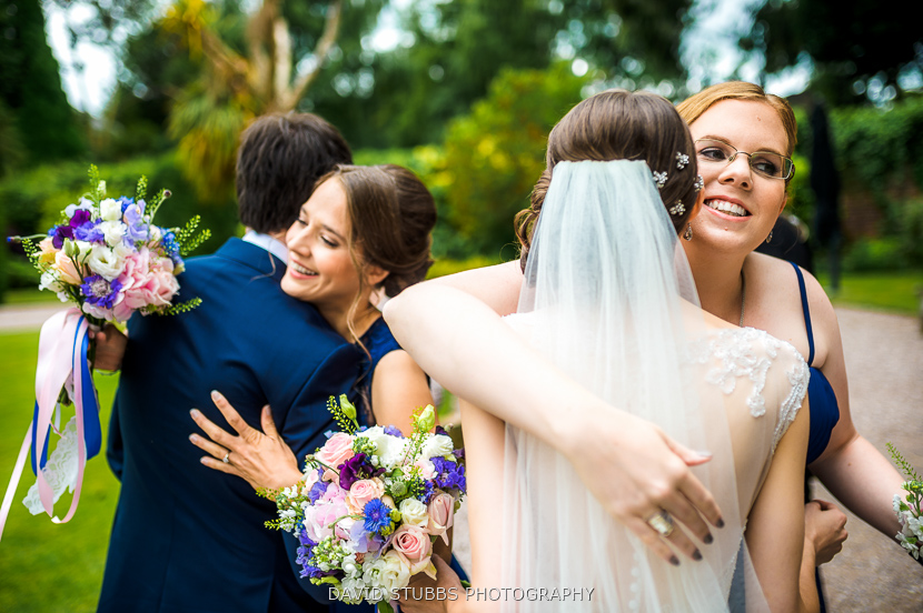 friends congratulating couple