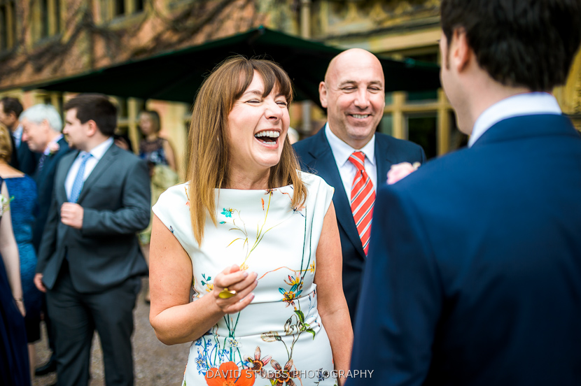 woman laughing with groom