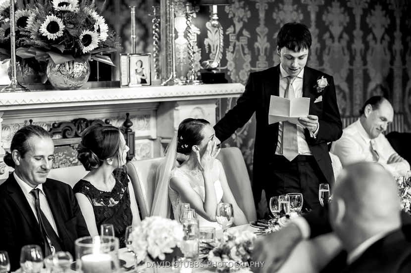 groom reading from paper