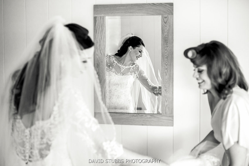 reflection of woman in wedding dress