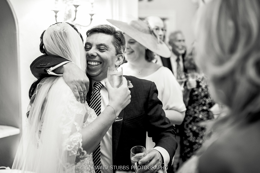 man hugging bride