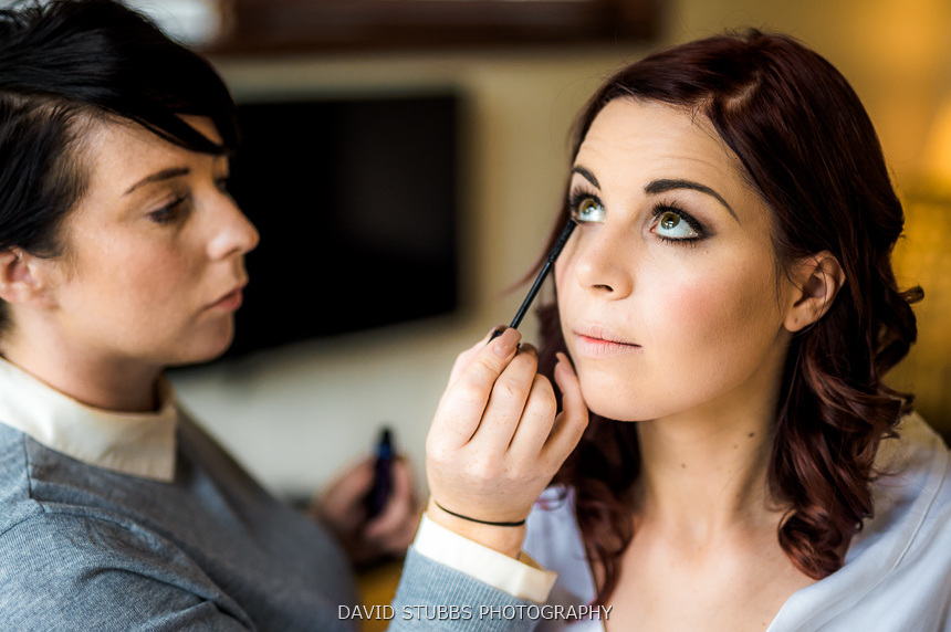 bride having make-up done