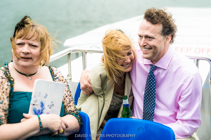 guests sat on boat colour photo