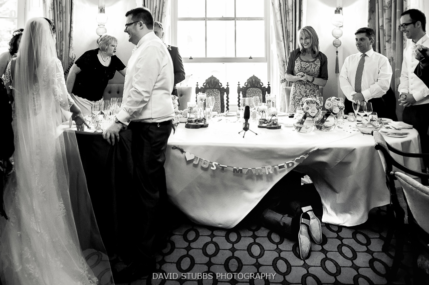 man crawling black and white wedding
