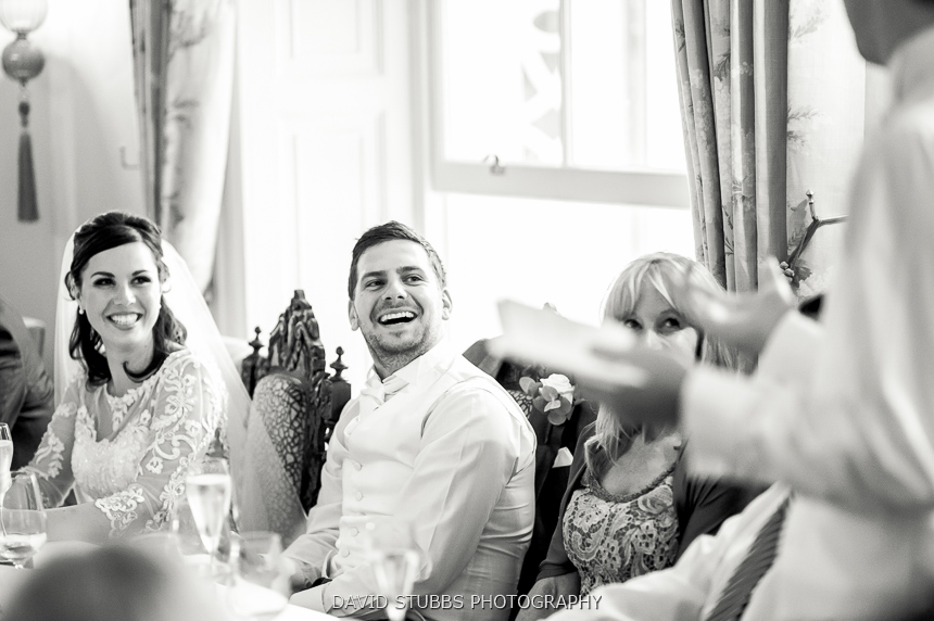 groom laughing black and white