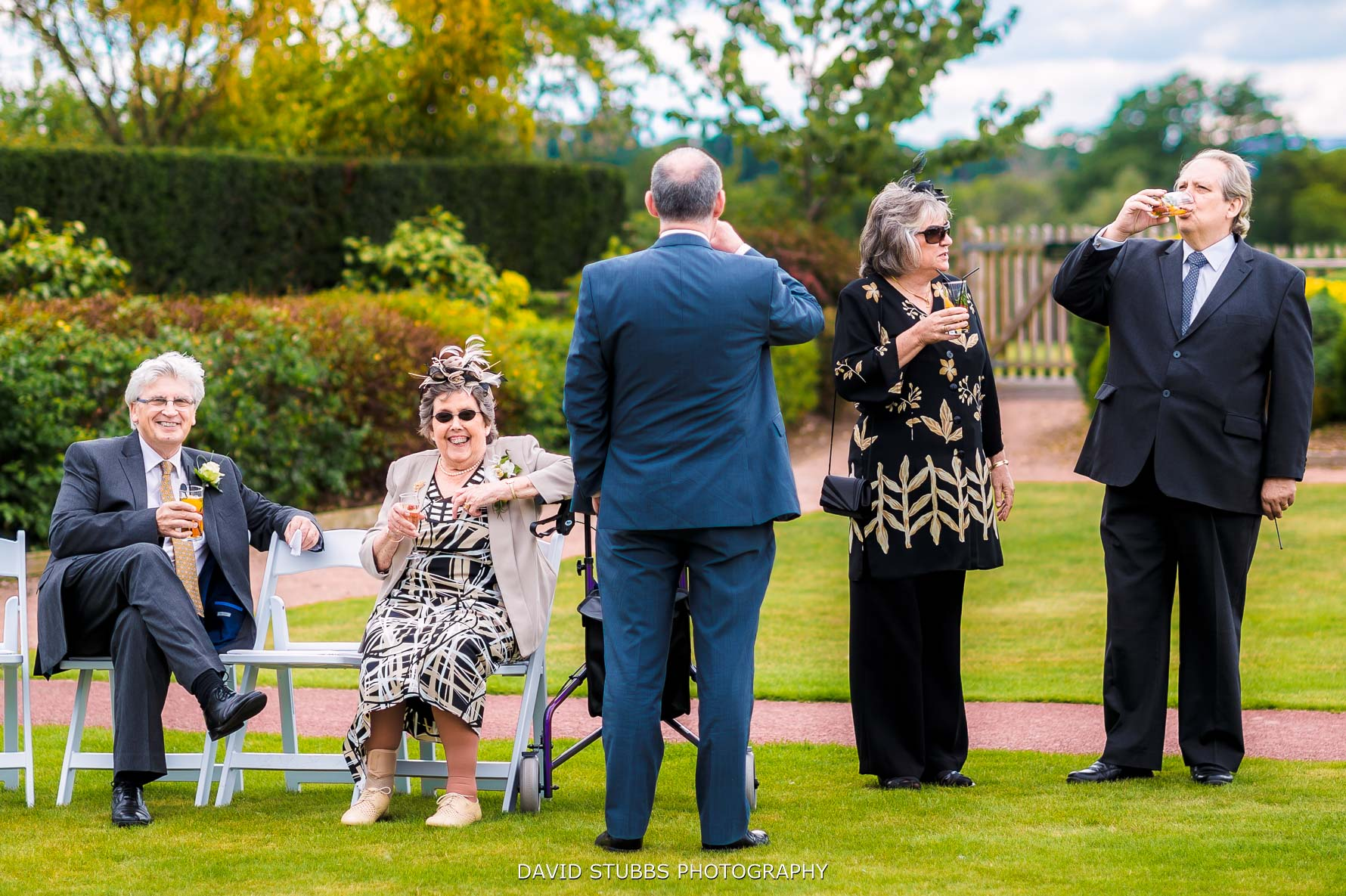 guests standing outside on the lawn